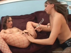 Horny lesbians Amber Rain and friend playing with a big toy dildo