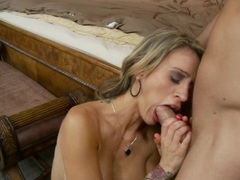 Big boobed Sarah Jessie blows a hard meat dick