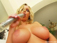 Peach masturbating her twat with a hard toy at the couch