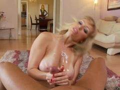 Adrianna Nicole gets sprayed with a fresh load of cum on her big tits