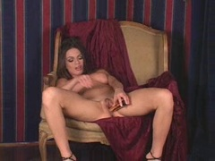 Avery Adams loves to fills her twat with a toy on the chair