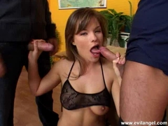 Busty babe Luci Love swallows two meaty cocks
