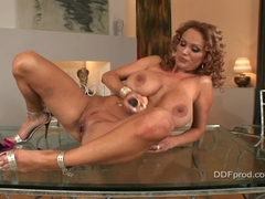 Sharon Pink on the glass table playing wher big tits with a rubber toy