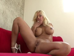 Busty babe Shyla Stylez strips and fingers her thick wet pussy