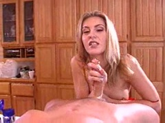 Blonde babe April Summers doing a nasty handjob