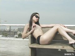 Sexy teen Sasha Grey stripping and posing her hot body outdoors