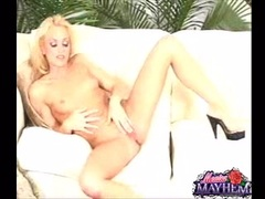 Blonde babe Monica Mayhem playing herself on the couch