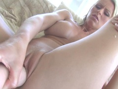 Hot babe Dasha fills her wet pussy with a rubber cock
