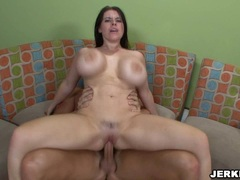 Daphne Rosen gets sparyed with a fresh load of cum on her gigantic boobed