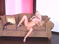 Stunning blonde babe Jana Cova dildoing herself on the couch