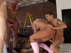 Nikki Hunter blowing while getting fucked by two cocks on her holes