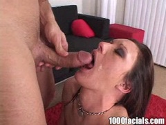 Taylor Rain gets sprayed with a fresh load of cum in her mouth