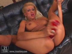 Pornstar Clara G shoving massive red dildo in her tight twat