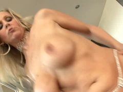 Blonde busty Julia Ann gets her twat sits on a black gigantic cock