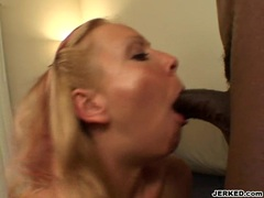 Horny babe Julie Knight takes a big black cock on her mouth