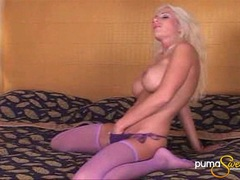 Busty pornstar Puma Swede fingers her pussy wearing sexy purple stockings