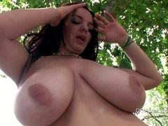 Busty brunette babe Joanna Bliss posing hot outside