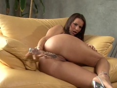 Horny babe Claudia Rossi toying her wet pussy in the couch