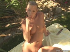 Sexy blonde Jana Mrhacova strips and plays her pussy outdoors