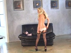 Horny babe Malibu toying her wet pussy on the couch