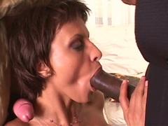 Busty chick Veronica Vanoza blowing two huge pricks