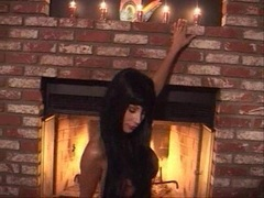 Naked babe Puma Swede plays her pussy in front of the fireplace
