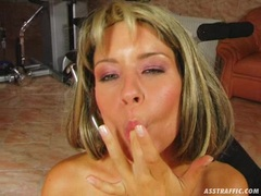 Lora Craft recieves a warm load of cum in her mouth