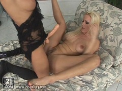 Lesbian Vega Vixen fucked by Nikki Rider's strap on