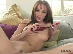 Charlie Laine fills her twat with a thick stick on the bed