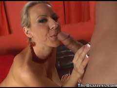 Milf slut Carolyn Reese munches a young cock on the couch