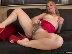 Busty nympho Sunny Lane inserting a glass dong in her shaved slits