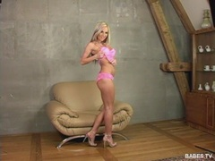 Sexy blonde Vanessa Cooper stripping her pink outfit