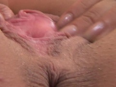Brunette babe Simony Diamond masturbates her pussy hard on the couch