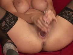 Horny Nikki Rider shoves a huge glass dildo in her tight wet hole