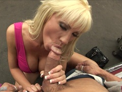 Hot slut Tanya James plugs an awesome cock in her juicy mouth