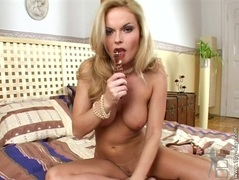 Busty blonde Chloe Sweet shoves a huge glass dildo in her tight twat