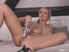 Slut Clara G stuffing a huge dildo deep in her tiny hole
