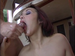 Brunette babe Katsumi gets her juicy mouth messed up with cock spurt