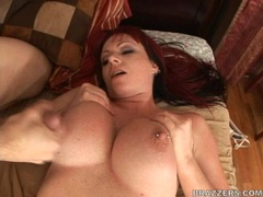Horny slut Kylie Ireland rides a big dick and gets her massive boobs cummed