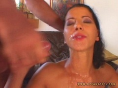 alluring cock lover Angel Dark receiving a warm spray of milky jizz on her mouth