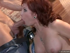 Redheaded Brittany Oconnell fills her warm mouth with a young meaty cock