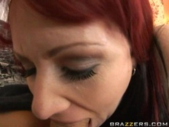 Red haired milf Kylie Ireland stuffs her mouth wiith a man meat sausage