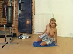 Blonde hottie Peach gets on the floor rubbing her rubbing her widely spread twat