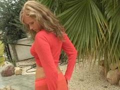 Sexy blonde honey Raylene Richards getting hot fondling her boobies