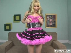 Cute blonde Angie Savage posing her meaty boobs under her awesome dress