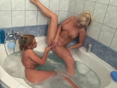 Bitchy blonde Dorothy Black fingering her busty gilfriend in the bathtub