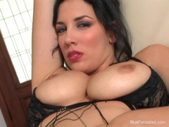 Beautiful Jelena Jensen gently rubbing her sweet slices on the couch