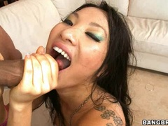 Bitchy babe Asa Akira spits out a load of cock paste on her hands