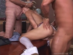 Jasmine Lynn takes two huge cocks at the same time in a school orgy