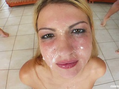Blonde babe Michelle B gets her face all covered with slimey cum